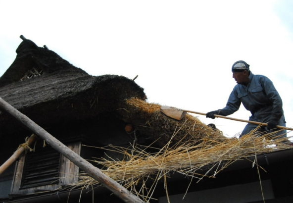 Replacing thatched roof.